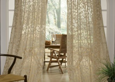 Sheer Cream Curtains on Decorative Rod