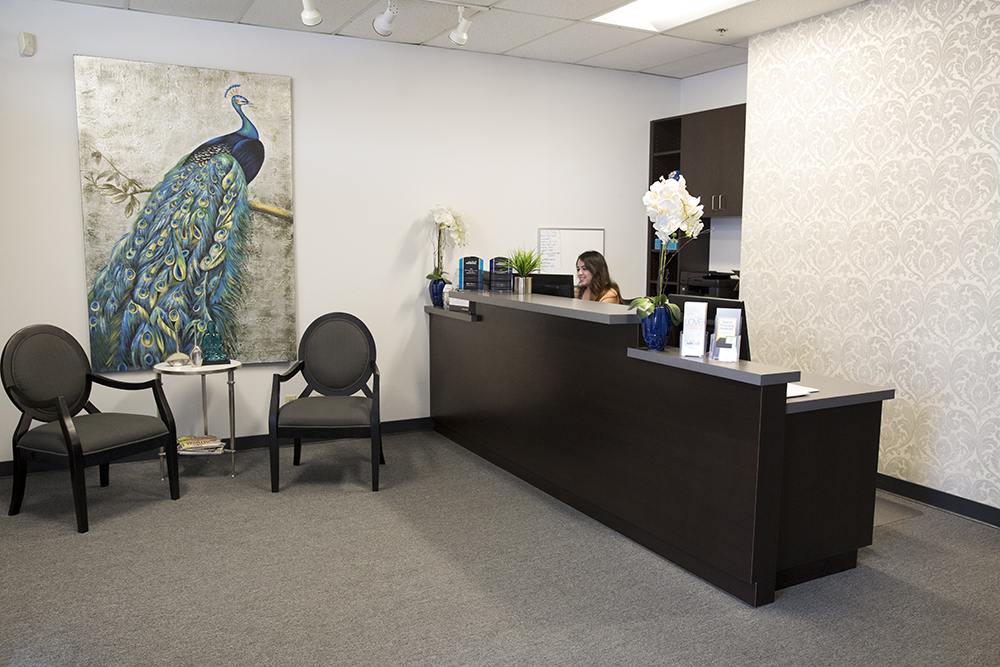 Receptionist working in the lobby of Galaxy Draperies.