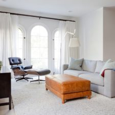 Modern designed custom window draperies in a living room.
