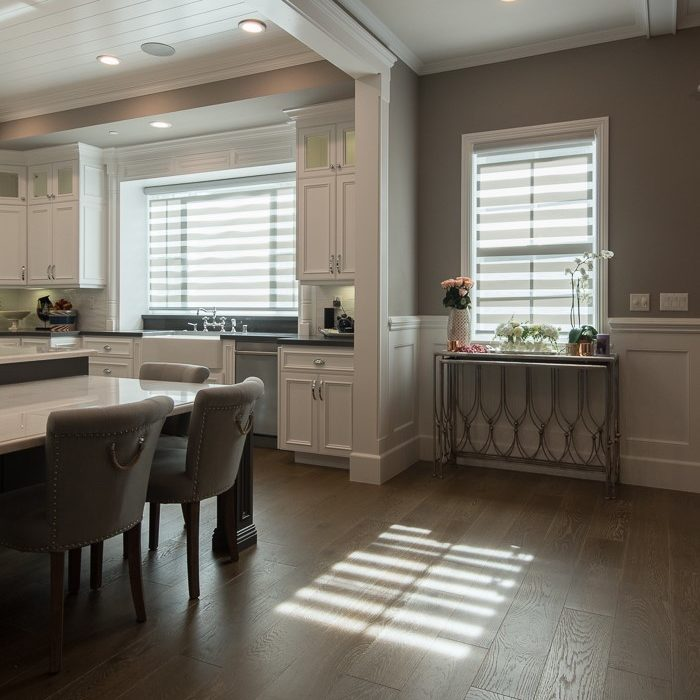 custom fitting window covering blinds and shades give a cohesive look from the outside