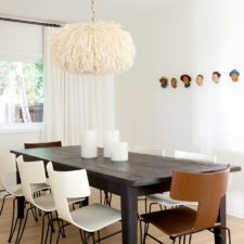 Custom white draperies framing a modern designed dining room.