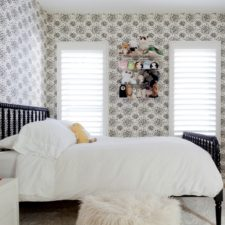 Modern vinyl shutters covering two vertical windows in a sleekly designed child's bedroom.