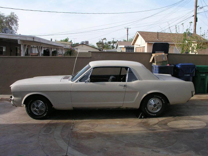 Side view of a 1969 white mustang.