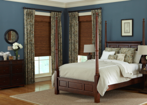 blue bedroom with draperies and shades