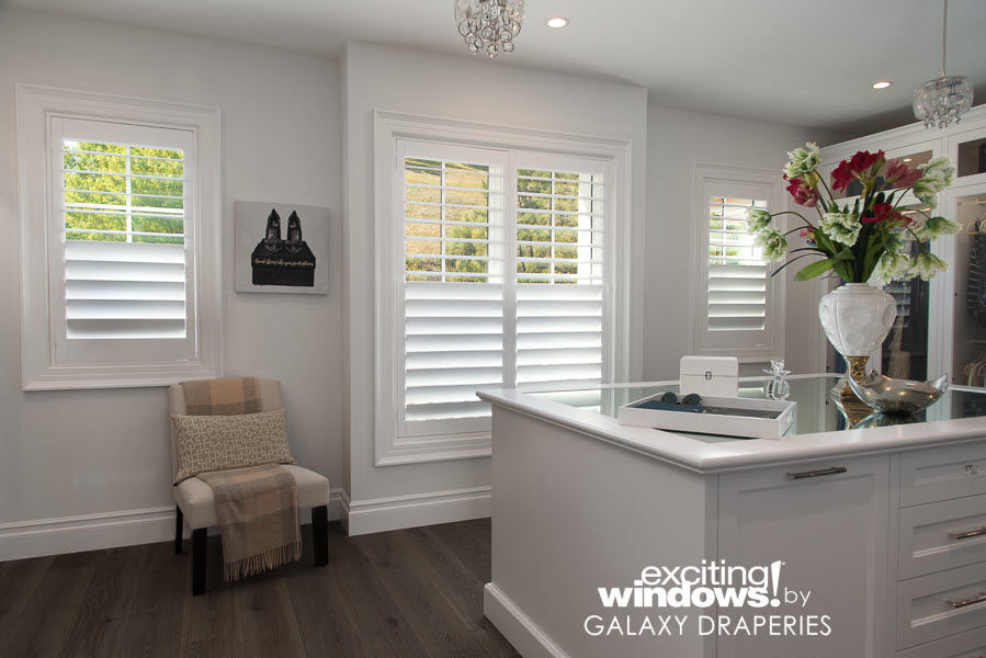 Light through the top, privacy through the bottom - this closet is perfect with split shutters. Custom window coverings are the perfect solution in any space.