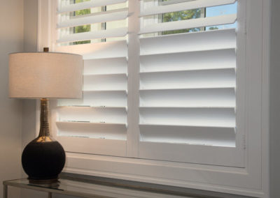 Split shutters with hidden tilts allow customization and maintain a clean look.