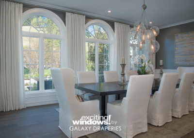 The chandelier and curtain rod and finials match beautifully for a perfectly cohesive design.