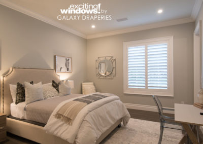 The guest bedroom looks classy and timeless with new shutters.