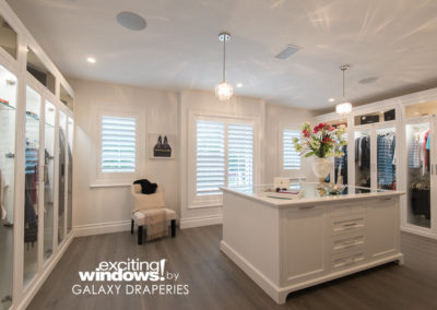 "This custom ""hers"" closet is amazing with privacy and natural light coming through the shutters."