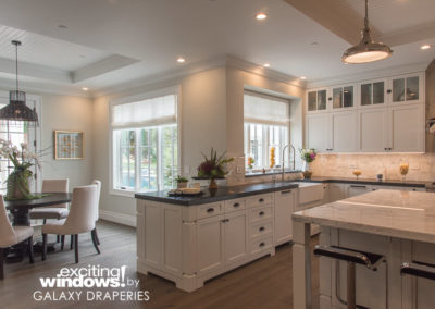 Light-filtering roller shades in the kitchen let plenty of natural light into the open space.