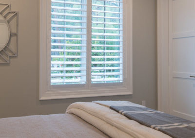 New shutters in the bedroom let in plenty of natural light.