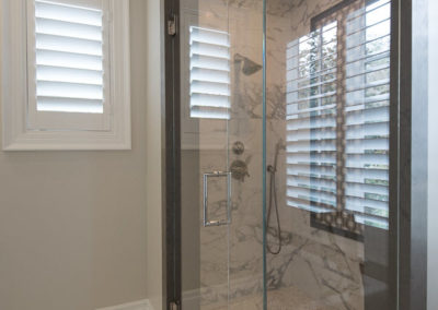 Tilt shutters in bathrooms allow privacy while still letting light pass through.