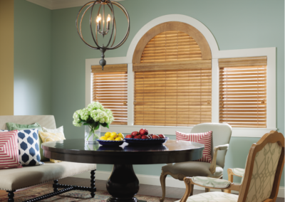 Custom-made wooden blinds can even fit uniquely shaped windows.