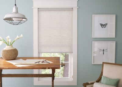 The light blue with white and wood accents gives a calming and minimalist look.