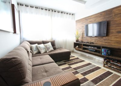 A wood panel accent wall makes for a beautiful background.