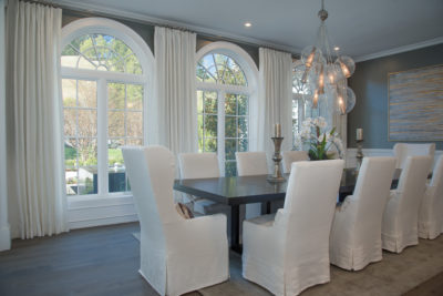 dining room with soft white curtain panels