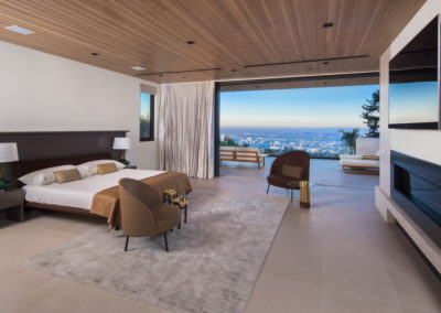 Beautiful sliding walls and automated sliding draperies overlook LA