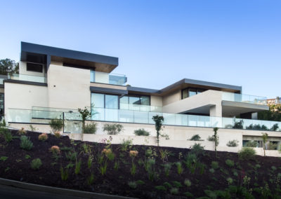 The sleek, modern design upon a hill gives loads of privacy, despite the many windows.