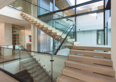 Intricate stairs and windowed walls allow a clear view of the tank from many parts of the home_