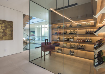 Private wine cellar with beautiful glass walls.
