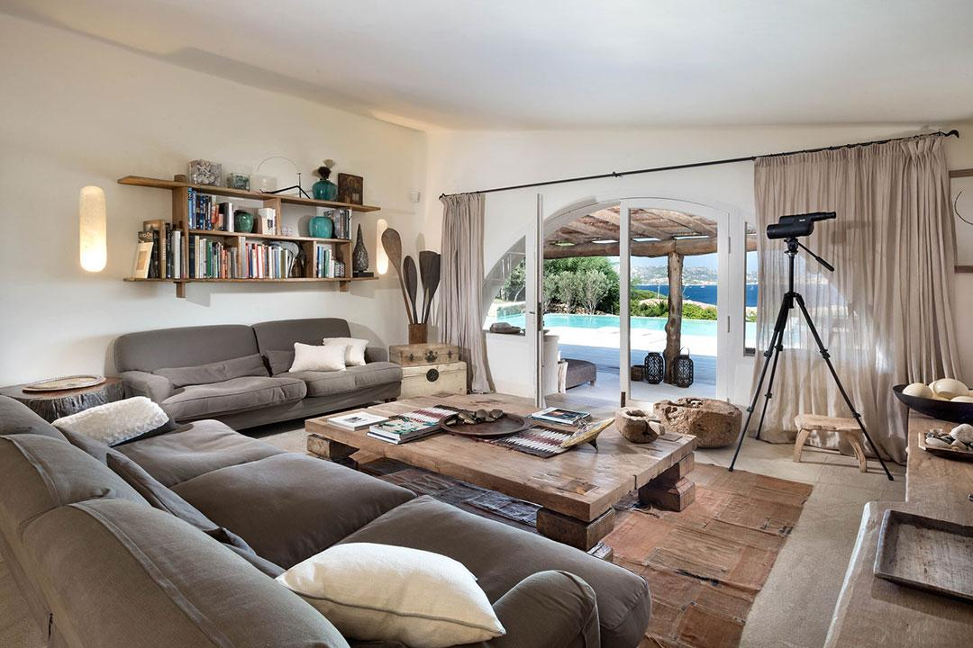 large living room with natural toned wood and large camera on tripod