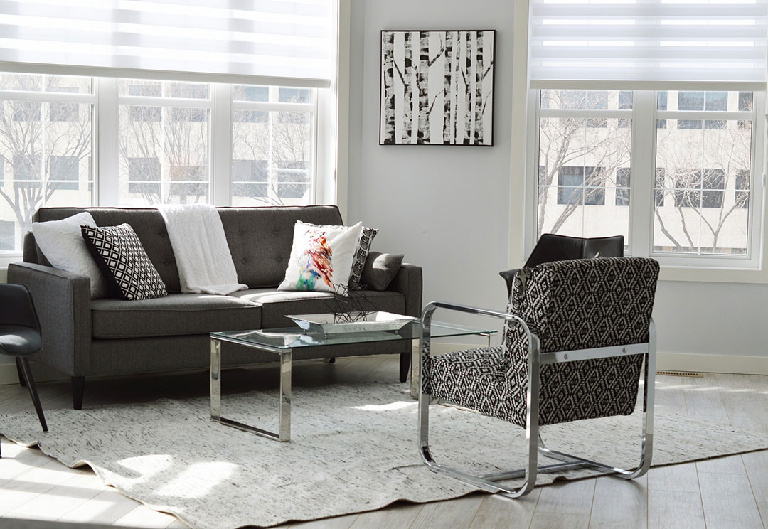 living room with chrome frames on black patterned chairs