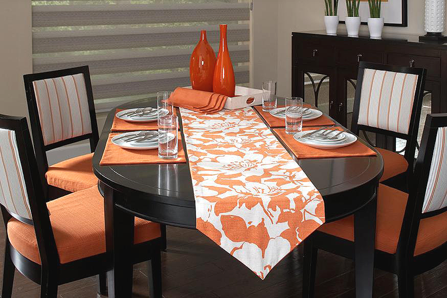 Reupholster furniture to match decor, rather than replacing it, like this beautiful orange and white dining room set.