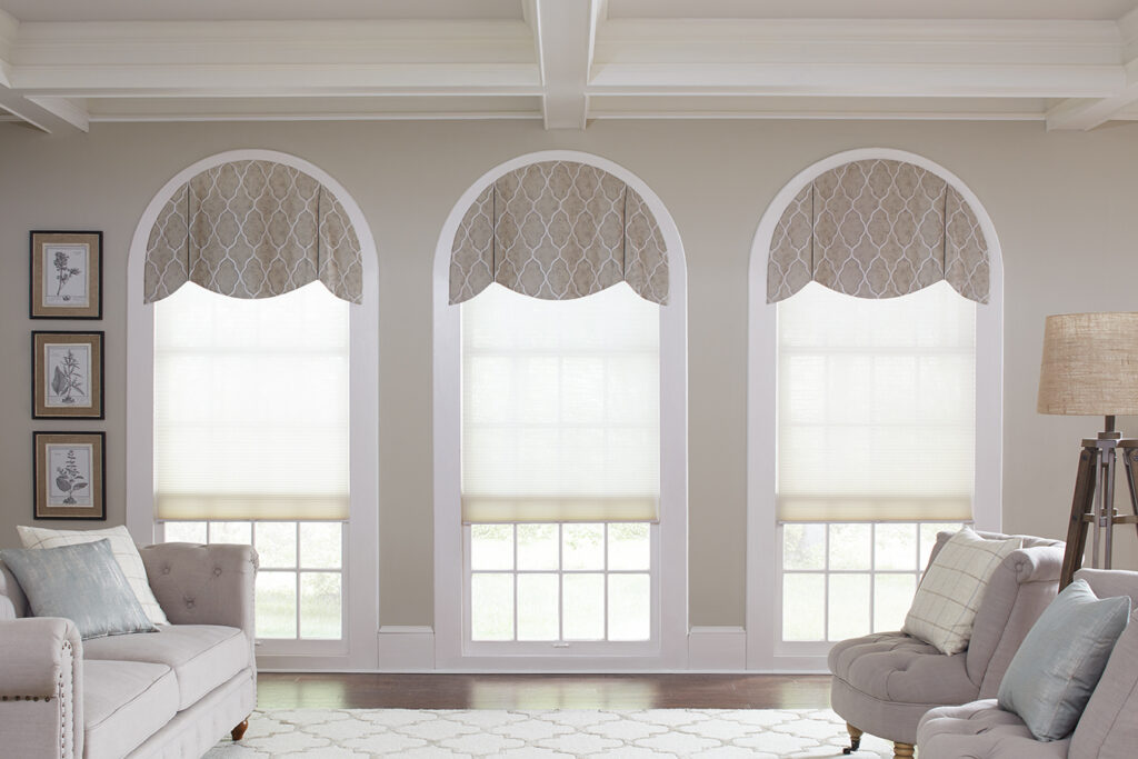 Valances hang decoratively across the top of three arched windows